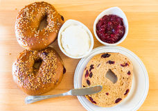 Homemade whole grain bagels with sesame seeds and cranberries. Stock Image