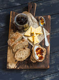Homemade whole grain bread, cheese and figs jam. Delicious breakfast or snack. Royalty Free Stock Photos