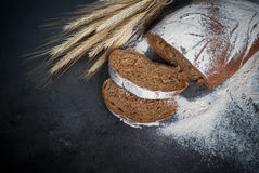 Homemade whole grain bread. On a dark background royalty free stock image