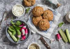 Homemade whole grain rolls, cottage cheese, fresh vegetables - radishes, cucumbers, lettuce on a grey stone background. Healthy sn. Ack in a rustic style. Top Royalty Free Stock Image