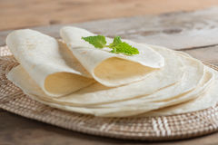 Homemade whole wheat flour tortillas. Homemade whole wheat flour tortillas on wooden table stock images