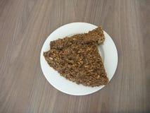 Homemade wholegrain bread on a white plate Stock Photos