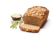 Homemade wholemeal rye bread with almonds isolated on white royalty free stock photography