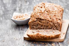 Homemade  wholemeal  rye bread with flax seeds on wooden table Stock Images