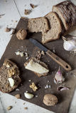 Homemade wholemeal sliced bread with walnuts, parmesan cheese and garlic Stock Images