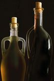 Homemade wine. Bottles filled with wine isolated on a dark background Stock Photography