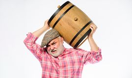Homemade wine. Winery concept. Man bearded senior carry wooden barrel for wine white background. Producing wine family. Tradition. Fermentation product. Natural stock photo