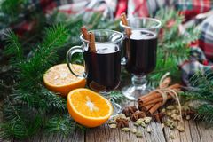 Homemade winter mulled wine with ingredients on table Royalty Free Stock Photo