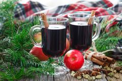 Homemade winter mulled wine with ingredients on table Stock Photo