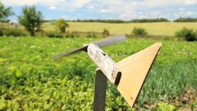 Homemade wooden airplane weather vane by the farm field. On a sunny day stock video footage