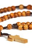 Homemade wooden rosary. Isolated on the white background royalty free stock photo