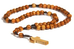 Homemade wooden rosary. Isolated on the white background royalty free stock photos
