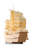 Homemade wooden ship with paper sails and flag. View from stern Stock Image
