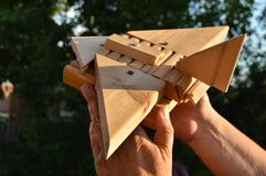 Homemade wooden toy airplane in the hands of men, the concept of journey, dreams, freedom, playing with the child royalty free stock image