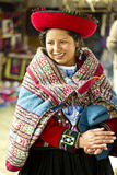 Homemade wool clothes worker. CHINCHERO, PERU - JUNE 6, 2013: Woman dressed traditionally while working on a homemade wool clothes industry. June 6, 2013 in Royalty Free Stock Images