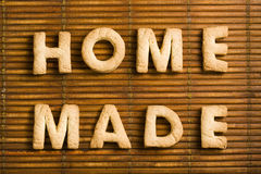 Homemade Word with Homemade Biscuits Letters. Photo featuring Home Made words composed of homemade biscuits letters arranged on wooden background Stock Images