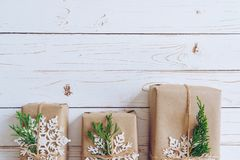Homemade wrapped christmas gift box presents on a wood table bac stock photo