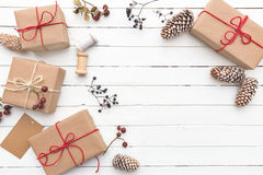 Homemade wrapped rustic brown paper packages with various natural things on white wooden surface Royalty Free Stock Photography