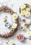 Homemade wreath with flowers and accessories for crafts creativity on a light background, top view. Flat lay Royalty Free Stock Photo