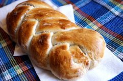 Homemade yeast braided bread. Homemade traditional braided bread - zopf, challah, brioche, close up Stock Photos