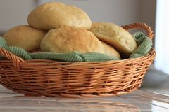 Homemade yeast bread rolls in a basket. Freshly baked homemade yeast bread rolls resting in a wicker basket royalty free stock image