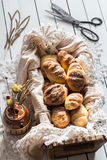 Homemade Yeasted Honey Cornbread Loaves in a Wooden Box and Dried Flowers Royalty Free Stock Images