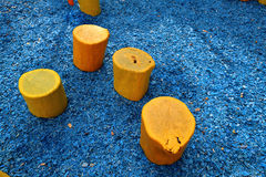 Homemade yellow stools. Yellow wooden seat hand made from the trunks of oak Stock Photos