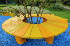 Homemade yellow table. Yellow wooden table hand made from the trunks of oak Royalty Free Stock Photo