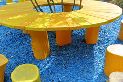 Homemade yellow table. Yellow wooden table hand made from the trunks of oak Stock Photography