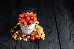 Homemade yoghurt with flakes, nuts and berries of raspberries and cherries royalty free stock photography