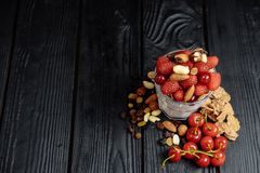 Homemade yoghurt with flakes, nuts and berries of raspberries and cherries stock photo
