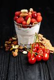 Homemade yoghurt with flakes, nuts and berries of raspberries and cherries stock photography