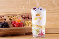 Homemade yogurt. Yogurt with berries. Against the background of nuts and dried fruits Royalty Free Stock Image