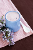 Homemade yogurt with berries and a bouquet of flowers Royalty Free Stock Images