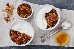 Homemade yogurt bowl with granola on black table, healthy and diet breakfast, from above Royalty Free Stock Photo