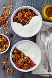 Homemade yogurt bowl with granola on black table, healthy and diet breakfast, from above Stock Photo