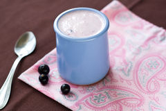 Homemade yogurt in a ceramic bowl on a pink tablecloth Royalty Free Stock Photo