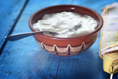 Homemade yogurt. In a ceramic bowl and spoon Stock Photo