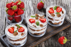 Homemade yogurt in cups with whole grain flakes Royalty Free Stock Photography
