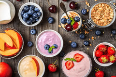 Homemade yogurt with fresh strawberry, blueberry, peach. Homemade yogurt on a wooden background, top view. Healthy food, Diet, Detox, Clean Eating or Vegetarian Royalty Free Stock Photo
