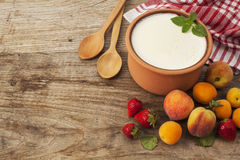 Homemade yogurt and fruits on wooden table stock photo