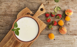 Homemade yogurt and fruits on wooden table Royalty Free Stock Photos