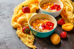 Homemade yogurt with granola, apricot and pine nuts stock photo