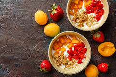 Homemade yogurt with granola, apricot and pine nuts stock photo