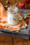 Homemade yogurt and a jar with dried apricots and nuts Royalty Free Stock Images