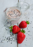 Homemade yogurt in a jar with strawberry Royalty Free Stock Images