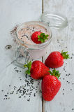 Homemade yogurt in a jar with strawberry Royalty Free Stock Image