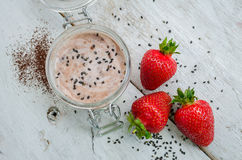 Homemade yogurt in a jar with strawberry Stock Photos