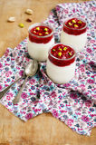 Homemade yogurt with mashed raspberry and pistachio nuts Stock Photo