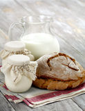 Homemade yogurt, milk and bread on a wooden table Royalty Free Stock Photo